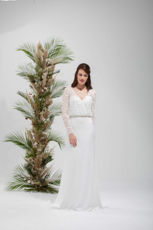 Sage brudekjole i tidløst og boheme design. Vi har et stort udvalg i brudekjoler.